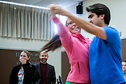 Javier Ronquillo demonstrates Contradance with student Abigale Morgan during his mathematics class for educators in Morton Hall on Friday, February 13. Ronquillo combines contradance with mathematics to show his students an innovative way to teach.