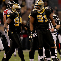 2009 November 02:  New Orleans Saints defensive end Will Smith (91) celebrates with defensive end Charles Grant (94) after sacking Atlanta Falcons quarterback Matt Ryan (not pictured) during a game at the Louisiana Superdome in New Orleans, Louisiana.