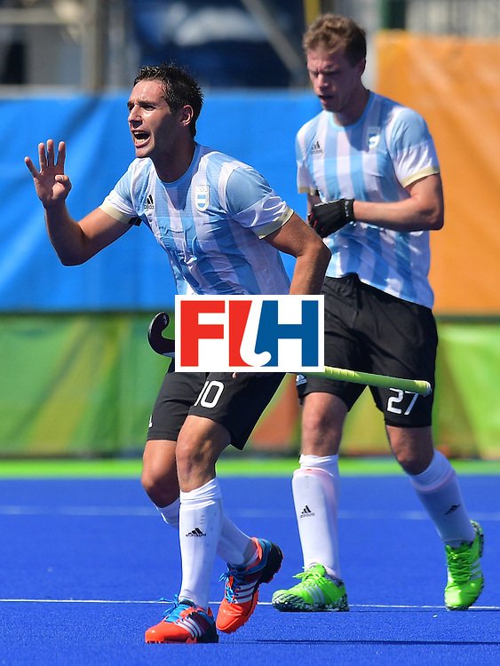 Argentina's Matias Paredes celebrates a goal during the men's field hockey Argentina vs Netherlands match in the Rio 2016 Olympics Games on August, 6 2016 at the Olympic Hockey Centre in Rio. / AFP / Carl DE SOUZA        (Photo credit should read CARL DE SOUZA/AFP/Getty Images)