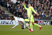 MK Dons forward Rob Hall  is tackled by Brighton central midfielder, Beram Kayal (7) during the Sky Bet Championship match between Milton Keynes Dons and Brighton and Hove Albion at stadium:mk, Milton Keynes, England on 19 March 2016. Photo by Dennis Goodwin.