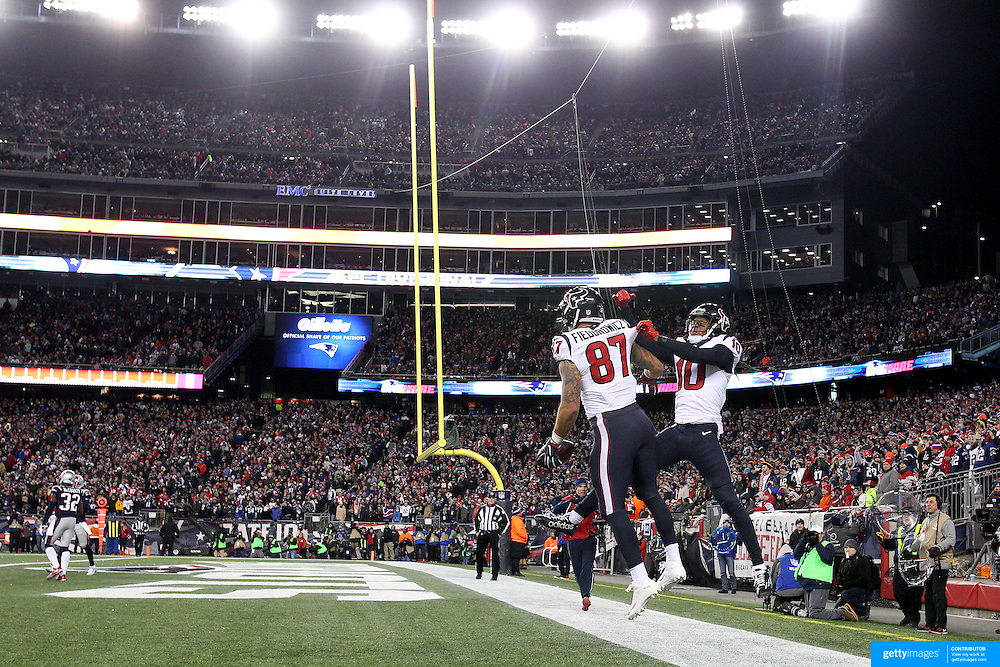 FOXBOROUGH, MASSACHUSETTS - JANUARY 14: Tight end C.J. Fiedorowicz #87 of the Houston Texans scores a touchdown and celebrates with team mate wide receiver DeAndre Hopkins #10 of the Houston Texans during the Houston Texans Vs New England Patriots Divisional round game during the NFL play-offs on January 14th, 2017 at Gillette Stadium, Foxborough, Massachusetts. (Photo by Tim Clayton/Corbis via Getty Images)