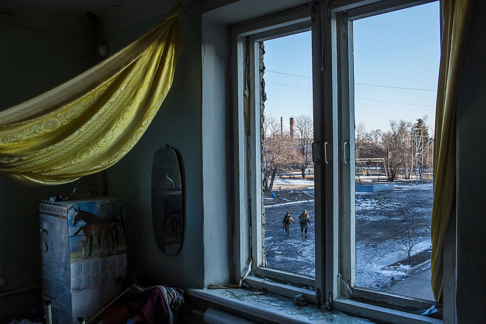 DEBALTSEVE, UKRAINE - FEBRUARY 20: Pro-Russian rebel fighters walk on the central square, as seen from the window of the municipal library on February 20, 2015 in Debaltseve, Ukraine. Ukrainian forces withdrew from the strategic and hard-fought town after being effectively surrounded by pro-Russian rebels, though fighting has caused widespread destruction. (Photo by Brendan Hoffman/Getty Images) *** Local Caption ***