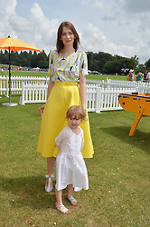 ROKSANDA ILINCIC and her daughter EFIMIA at the Veuve Clicquot Gold Cup Final at Cowdray Park Polo Club, Midhurst, West Sussex on 20th July 2014.