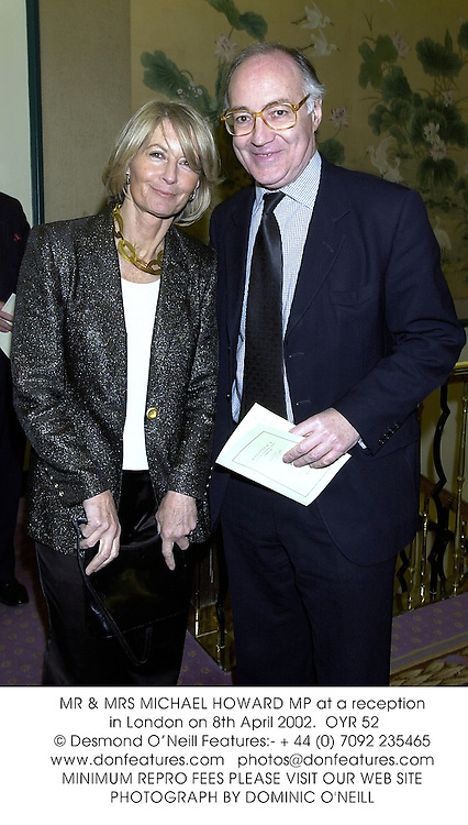 MR & MRS MICHAEL HOWARD MP at a reception in London on 8th April 2002.<br />OYR 52