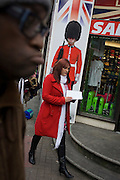 Coldstream guardsman appears on a poster outside a tourit shop in central London.