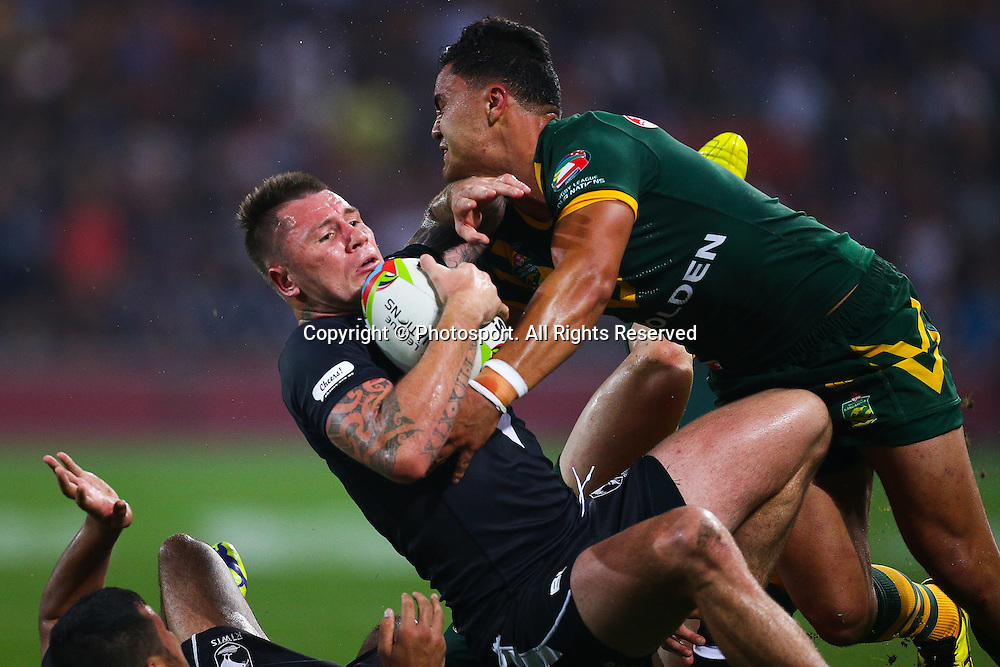 Shaun Kenny-Dowall is tackled by Josh Mansour during the Four Nations test match between Australia and New Zealand at Suncorp Stadium,  Brisbane Australia on October 25, 2014.