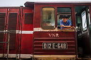 Portrait of a train conductor in Long Bien Station, Hanoi, Vietnam, Southeast Asia