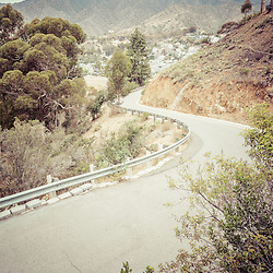 Catalina Island winding mountain road picture. Santa Catalina Island is off the coast of Southern California and is a popular travel and vacation destination.