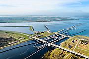 Nederland, Zeeland, Gemeente Schouwen-Duiveland, 01-04-2016; Philipsdam en Krammersluizen met Hoogbekken en Laagbekken. In de achtergrond Sint Philipsland.<br /> Dam en sluiscomplex vormen een compartimenteringswerk waardoor het zoete water van Volkerak en het zoute water van het Krammer gescheiden blijft. Het Krammer, aan gene zijde van de sluizen staat in verbinding met de Oosterschelde. Het geheel maakt deel uit maken van de Deltawerken.<br /> Philipsdam with Krammersluizen, part of the Delta Works. The locks form a division between sweet and salt water.<br /> <br /> luchtfoto (toeslag op standard tarieven);<br /> aerial photo (additional fee required);<br /> copyright foto/photo Siebe Swart