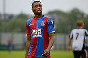 Aaron Bissaka catching the rain during the Pre-Season Friendly match between Tooting & Mitcham and Crystal Palace at Imperial Fields, Tooting, United Kingdom on 24 July 2015. Photo by Michael Hulf.