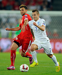 Switzerland's Admir Mehmedi battles for the ball with England's Jack Wilshere (Arsenal)  - Photo mandatory by-line: Joe Meredith/JMP - Mobile: 07966 386802 - 08/09/14 - SPORT - FOOTBALL - Switzerland - Basel - St Jacob Park - Switzerland v England - Uefa Euro 2016 Group E Qualifier