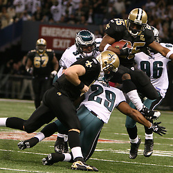 13 January 2007: New Orleans Saints running back Reggie Bush (25) hurdles to evade a trio of Philadelphia Eagles defenders during a 27-24 win by the New Orleans Saints over the Philadelphia Eagles in the NFC Divisional round playoff game at the Louisiana Superdome in New Orleans, LA. The win advanced the New Orleans Saints to the NFC Championship game for the first time in the franchise's history.