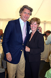 "ARNAUD BAMBERGER and the COUNTESS OF MARCH at a luncheon hosted by Cartier at the 2004 Goodwood Festival of Speed on 27th June 2004.  Cartier sponsored the ""Style Et Luxe' for vintage cars on the final day of this annual event at Goodwood House, West Sussex."