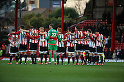 Brentford paying tribute to their former player Jimmy Hill during the Sky Bet Championship match between Brentford and Huddersfield Town at Griffin Park, London, England on 19 December 2015. Photo by Matthew Redman.