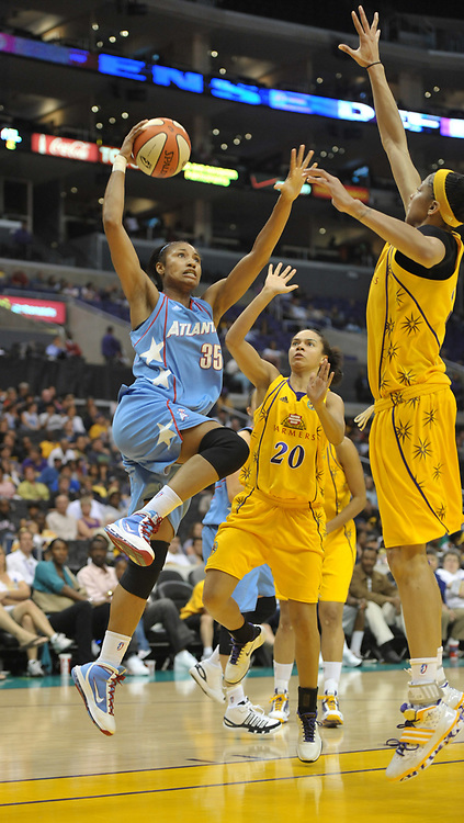 May 30, 2010; Los Angeles, CA, USA; Atlanta Dream forward Angel McCoughtry (35) is defended by Los Angeles Sparks guard Kristi Tolliver (20) and forward Candace Parker (3) in the second half at the Staples Center. The Dream defeated the Sparks 101-82.