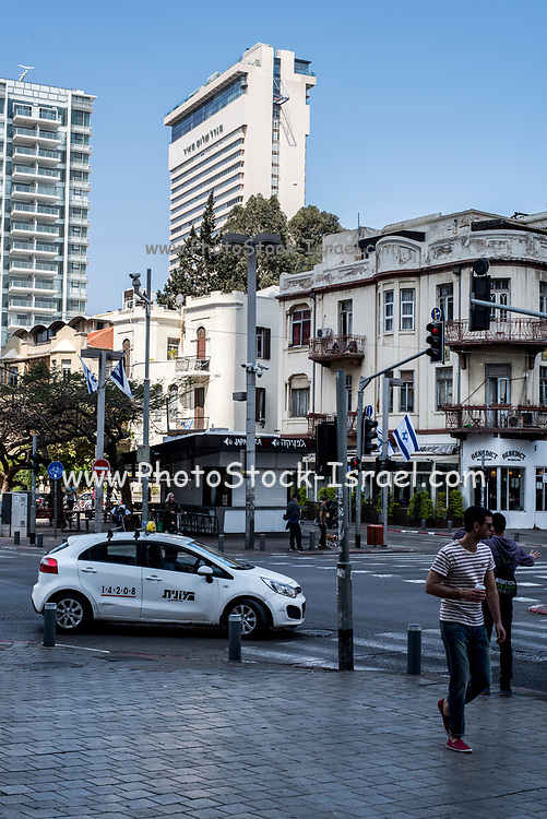 The corner of Allenby street and Rothschild Boulevard, Tel Aviv, Israel The Shalom tower in the background