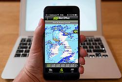Using iPhone smartphone to display weather radar image of rain across the United Kingdom