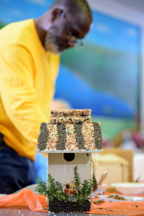 Upper Marlboro, Maryland - January 03, 2017: Fletcher James, a member of the Senior Green Team builds and decorates a birdhouse at the Watkins Park Nature Center in Upper Marlboro, Md., Tuesday January 3, 2017. The group meets the first Tuesday morning of each month and works on nature beautification projects like trail maintenance, tree planting, clean ups, and, educational outings. <br /> <br /> CREDIT: Matt Roth
