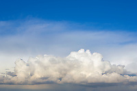 Thunderheads in blue sky.