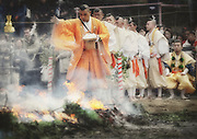 An ascetic Buddhist priest leads the way and scatters salt at the start of a purification ceremony in which monks of the Yakuoin Temple walk across burning embers in Takao, west of Tokyo, Japan on Sunday 09 March  2009.