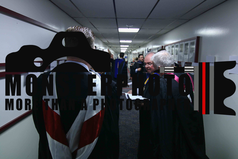Goldey-Beacom College Chuck Hammond, LEFT, and other faculty members prepare for commencement exercise Friday, May 1, 2015, at Joseph West Jones College Center on the campus of Goldey-Beacom College in Wilmington Delaware.