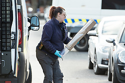 © Licensed to London News Pictures . 25/03/2018 . Manchester , UK . A sword is recovered from the scene in Chorlton-cum-Hardy as police close off a section of Upper Chorlton Road where clothes , used Tasers and a police baton lie scattered on the road and pavement following a reported struggle with a man , who was tasered at the scene . Photo credit : Joel Goodman/LNP