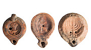 Roman period Terra-cotta Oil Lamps 3-4th century CE. The one on the right is Jewish with a seven branched Menorah