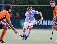 EINDHOVEN - hockey - Rogier Hofman tijdens de hoofdklasse hockeywedstrijd tussen de mannen van Oranje-Zwart en Bloemendaal (3-3). COPYRIGHT KOEN SUYK