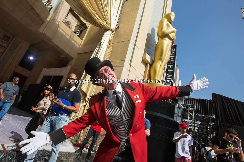 Greeter Gregg Donovan poses in front of the Dolby Theatre in Hollywood, Thursday, February 19, 2015. The 87th Academy Awards will be held Sunday, February 22, 2015.(Photo by Ringo Chiu/PHOTOFORMULA.com)