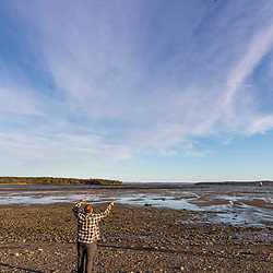 Flying a kite on a beach in Lubec, Maine.