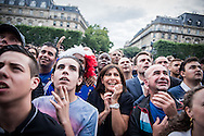 © Benjamin Girette / IP3 PRESS : Paris, France June 30th, 2014 : French supporters encouraging their team for a soccer match France against Nigeria for 2014 Brazil World cup. A big screen in front of the city Hall of Paris gathered thousand of supporters and the Mayor of Paris Anne HIDALGO