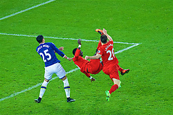 LIVERPOOL, ENGLAND - Monday, December 19, 2016: A Liverpool's Sadio Mane and Adam Lallana in action against Ramiro Funes Mori of Everton during the FA Premier League match against Liverpool, the 227th Merseyside Derby, at Goodison Park. (Pic by Gavin Trafford/Propaganda)