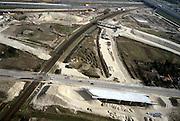 Nederland, Barendrecht, Eerste Barendrechtseweg, 08-03-2002;  aanleg Betuweroute, infrastructuur knooppunt: de Eerste Barendrechtseweg (onder in beeld) zal in de toekomst verlegd worden en over het viaduct geleid worden; het hoofdspoor loopt van rechtsonder, naar rechtsboven en gaat onder de A16 door; het viaduct (en zand) in het midden zijn voor een verbindingsboog die aansluit op bestaand spoor (richting  Rotterdam); de havenspoorlijn (rechtsonder - rechtsboven) verdwijnt na voltooing Betuweroute.bouwen verkeer en vervoer infrastructuur Betuwelijn.<br /> luchtfoto (toeslag), aerial photo (additional fee)<br /> foto /photo Siebe Swart
