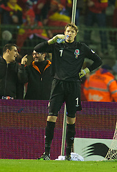 BRUSSELS, BELGIUM - Tuesday, October 15, 2013: Wales' goalkeeper Wayne Hennessey looks dejected as Belgium's Kevin De Bruyne celebrates scoring the first goal during the 2014 FIFA World Cup Brazil Qualifying Group A match at the Koning Boudewijnstadion. (Pic by David Rawcliffe/Propaganda)