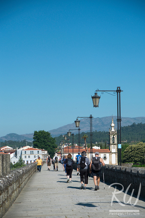 Backroads Camino de Santiago Tour Group Crossing Medieval Bridge, Ponte de Lima, Portugal