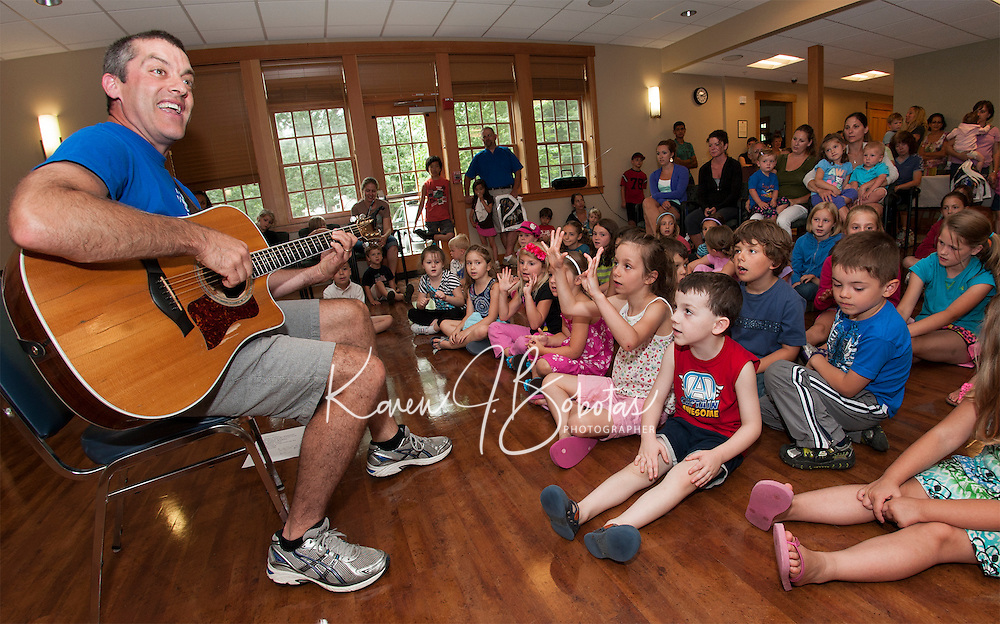 """Paul Warnick brings music and smiles to kick off the """"Dream Big"""" Summer Reading program at Gilford Library on Monday afternoon.   (Karen Bobotas/for the Laconia Daily Sun)"""
