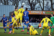 Fleetwood Town  defender Harry Souttar (6) winning header in the box with AFC Wimbledon goalkeeper Joe Day (21) looking on after he came up for a corner during the EFL Sky Bet League 1 match between AFC Wimbledon and Fleetwood Town at the Cherry Red Records Stadium, Kingston, England on 8 February 2020.