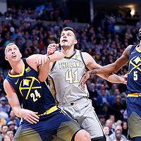 07 March 2018: Cleveland Cavaliers forward Ante Zizic (41) vies for the rebound with Denver Nuggets center Mason Plumlee (24) and Denver Nuggets forward Will Barton (5) during the Cleveland Cavaliers 113-108 victory over the Denver Nuggets, at the Pepsi Center, Denver, Colorado, USA.