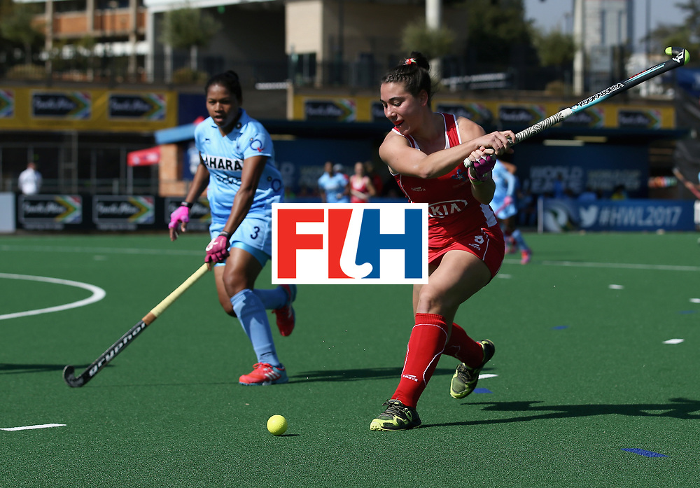 JOHANNESBURG, SOUTH AFRICA - JULY 12: Denise Krimerman of Chile and Deep Ekka of India battle for possession during day 3 of the FIH Hockey World League Semi Finals Pool B match between India and Chile at Wits University on July 12, 2017 in Johannesburg, South Africa. (Photo by Jan Kruger/Getty Images for FIH)