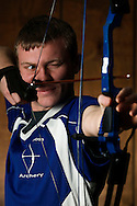 David Machart practices archery at Strawberry Hill Elementary School in Anamosa on Friday, Feb. 27, 2016. The Anamosa High School senior is the first participant in the Iowa Afterschool National Archery in the Schools Program to record a perfect 300 score in a sanctioned event. He did it Saturday, Feb. 20, at an approved league tournament in Anamosa. David, the defending state champion, finished second last year in both national and world competition and won a $10,000 scholarship in the national meet. He had previously recorded five 297s, a 298 and a 299 in competition. (Rebecca F. Miller/The Gazette)