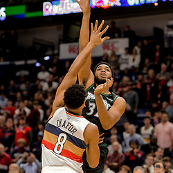 Dec 31, 2018; New Orleans, LA, USA; Minnesota Timberwolves center Karl-Anthony Towns (32) shoots over New Orleans Pelicans center Jahlil Okafor (8) during the first quarter at the Smoothie King Center. Mandatory Credit: Derick E. Hingle-USA TODAY Sports