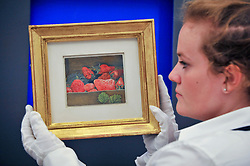"© Licensed to London News Pictures. 15/06/2017. London, UK. A staff member shows ""Strawberries"", 1950, by Lucien Freud (estimate GBP550k-750k).  Preview of Impressionist and Modern art sale, which will take place at Sotheby's New Bond Street on 21 June.  Photo credit : Stephen Chung/LNP"