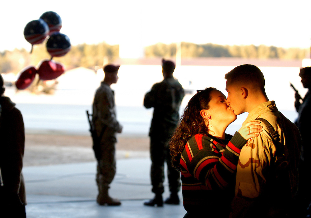 FORT BRAGG, NC 1/23/04:.Natasha Marsh greets her husband Sergeant Robert Marsh on his arrival to Pope Air Force Base in Fort Bragg, NC on 01/23/04. Approximately 150 soldiers assigned to the 37th Engineer Battalion returned to Fort Bragg, NC, after a 10-month deployment in Iraq in support of Operation Iraqi Freedom. Photo by Logan Mock-Bunting