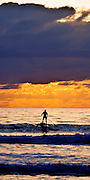 Surf Paddler at Cocoa Beach, Florida - Riding into the Sunrise
