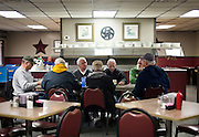 "MONTICELLO, IA – JANUARY 6: The ""Table of Knowledge"" shares opinions over breakfast at Darrell's in Monticello, Iowa on January 6, 2017."