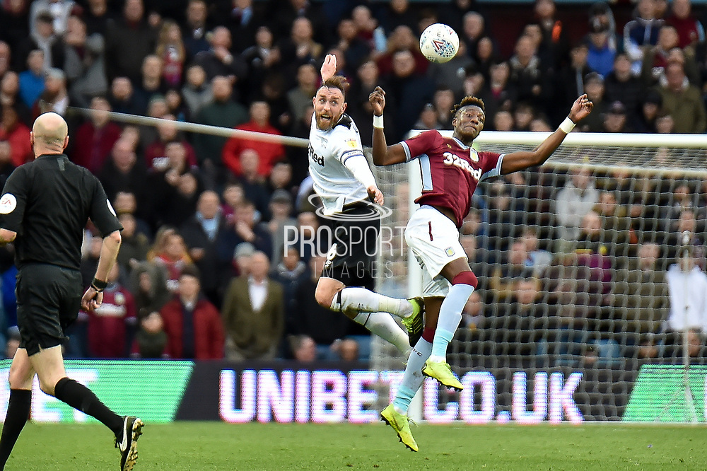 Derby County defender Richard Keogh (6) battles for possession with Aston Villa striker(on loan from Chelsea) Tammy Abraham (18) during the EFL Sky Bet Championship match between Aston Villa and Derby County at Villa Park, Birmingham, England on 2 March 2019.