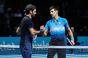Novak Djokovic shakes the hand of Roger Federer after winning during the final of the ATP World Tour Finals between Roger Federer of Switzerland and Novak Djokovic at the O2 Arena, London, United Kingdom on 22 November 2015. Photo by Phil Duncan.