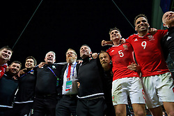 LILLE, FRANCE - Friday, July 1, 2016: Wales players celebrate in the team huddle following a 3-1 victory over Belgium and reaching the Semi-Final during the UEFA Euro 2016 Championship Quarter-Final match at the Stade Pierre Mauroy. Equipment manager David Griffiths, Doctor Rhodri Martin, Mike Murphy, head of international affairs Mark Evans, assistant manager Osian Roberts, Jamie Benito Plans, James Chester, Hal Robson-Kanu. (Pic by David Rawcliffe/Propaganda)