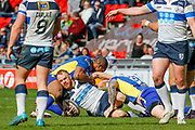 Featherstone Rovers hooker Matty Wildie (14) is tackled  during the Challenge Cup 2018 match between Doncaster and Featherstone Rovers at the Keepmoat Stadium, Doncaster, England on 22 April 2018. Picture by Simon Davies.