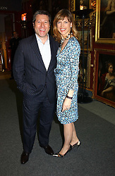 DJ NEIL FOX and news reader KATIE DERHAM at the Macmillan Cancer Relief Celebrity Christmas Stocking Auction held at Christie's, South Kensington, London on 8th December 2004.<br /><br />NON EXCLUSIVE - WORLD RIGHTS